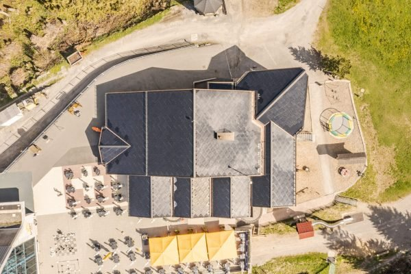 Aerial view of SunStyle solar tiles on the roof of Ristis Restaurant at Brunni